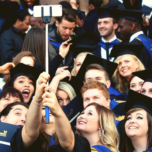 students-taking-selfies-on-graduation-day
