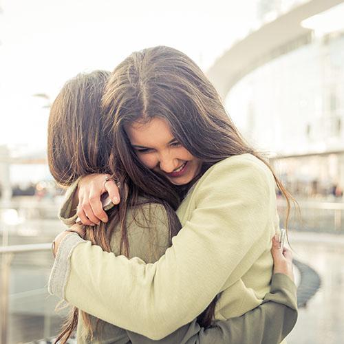 2-female-students-hugging