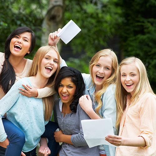 5-female-students-celebrating-exam-results
