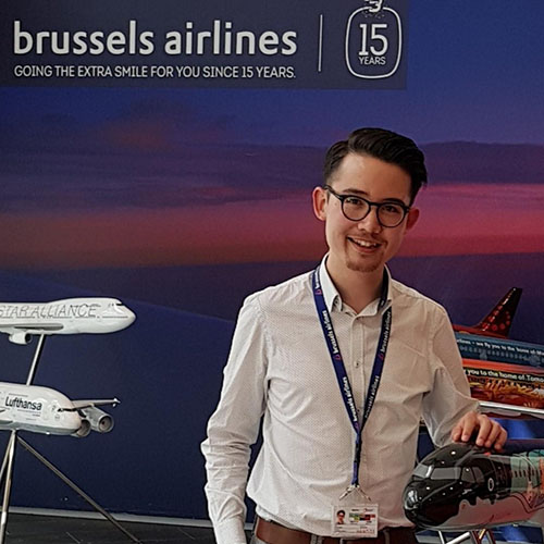 student-jeremiah-standing-outside-brussells-airlines-stand